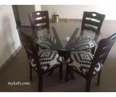 Dining table with 4 chairs very good condition with warranty