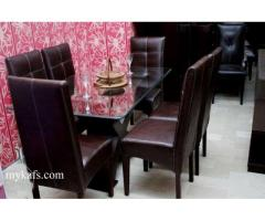 New modern dining table | six full cushion chairs.